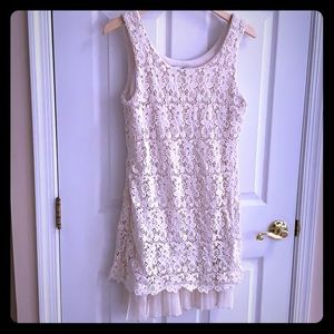 White lace dress from Soho. Silky Pleated hemline